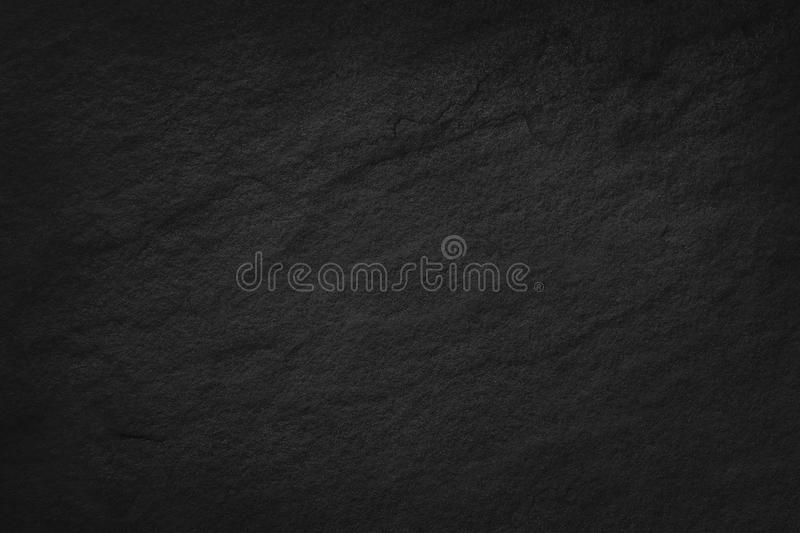 Dark grey black slate texture in natural pattern. Black stone wall. royalty free stock images