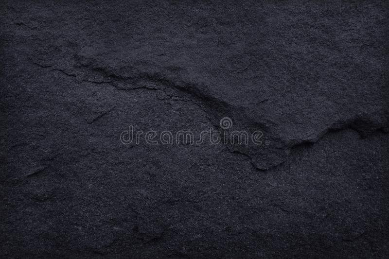 Dark grey black slate texture in natural pattern. Black stone wall. Dark grey black slate texture in natural pattern with high resolution for background and royalty free stock photography