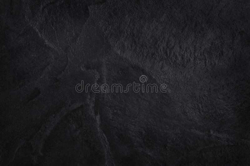 Dark grey black slate texture in natural pattern. Black stone wall. Dark grey black slate texture in natural pattern with high resolution for background and stock photos