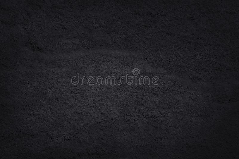 Dark grey black slate texture in natural pattern with high resolution for background and design art work. Black stone wall royalty free stock photography