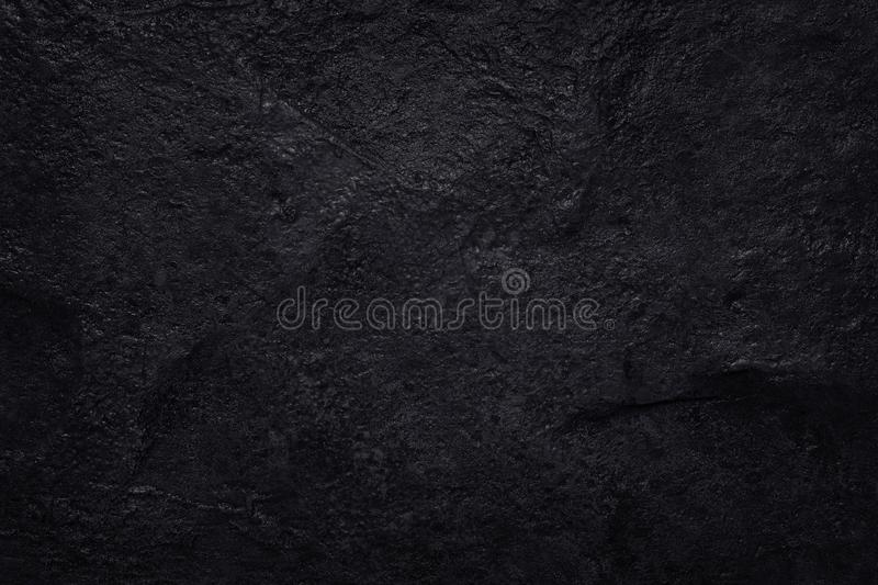 Dark grey black slate texture in natural pattern. Black stone wall. royalty free stock photo