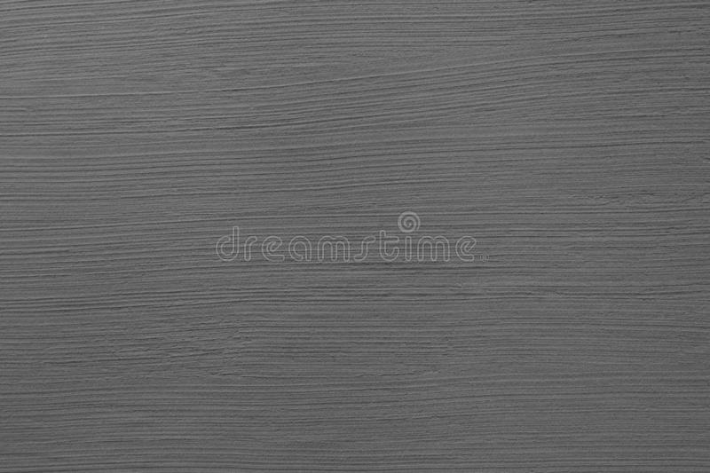 Dark grey cement wall with rustic natural brush stroke texture for abstract background and design purpose. Dark grey cement wall with rustic natural brush stroke royalty free stock images