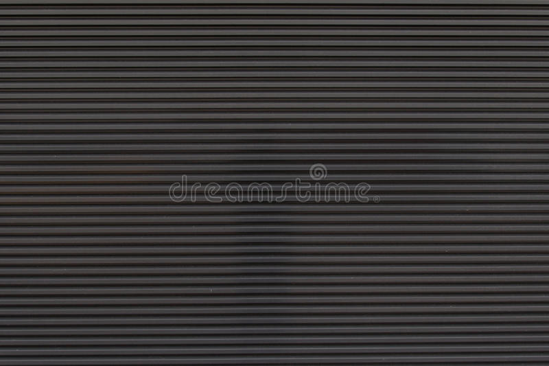 Dark grey garage door royalty free stock photography
