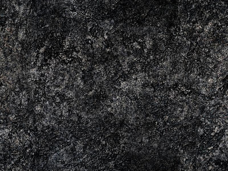 Dark grey natural raw seamless granite stone texture pattern background. Rough natural stone seamless texture surface with cracks, royalty free stock photo