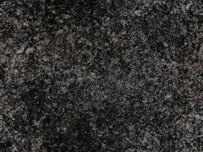 Dark grey natural raw seamless granite stone texture pattern background. Rough natural stone seamless texture surface with cracks, stock image
