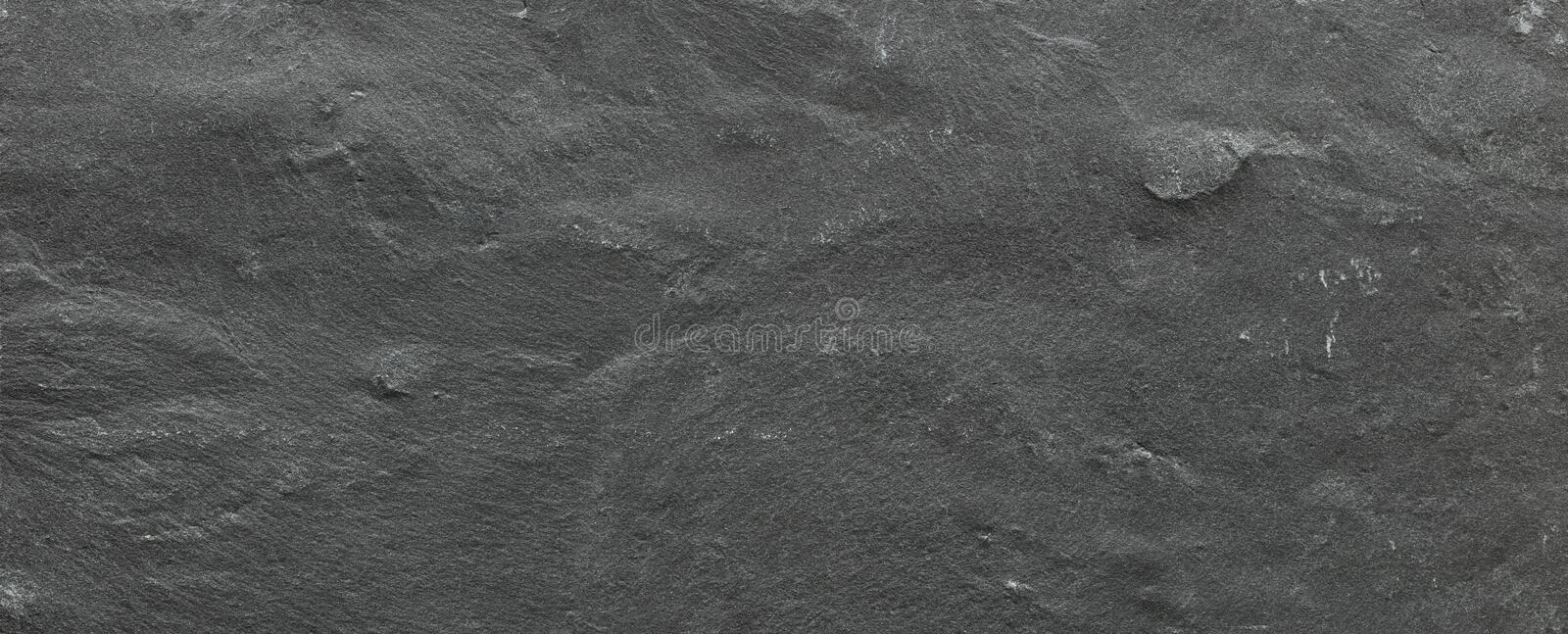 Dark grey ore black slate background or texture, Dark stone background, stone texture royalty free stock photography