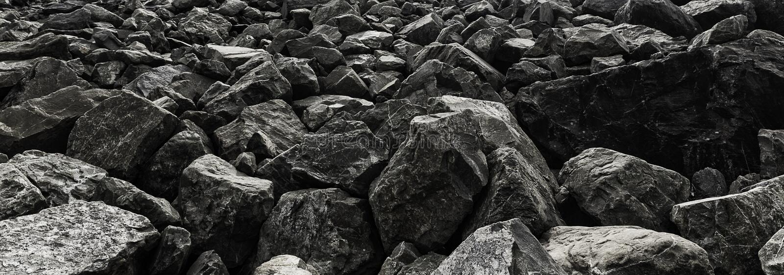 Dark grey rocky stones panoramic texture image. Dark grey big rocky stones panoramic texture image for background royalty free stock image