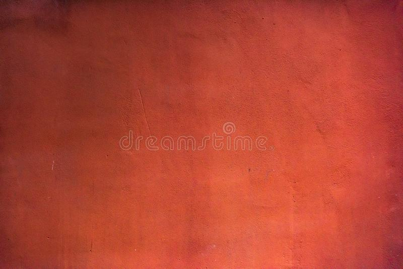 Dark grunge concrete wall texture painted in red color stock photo