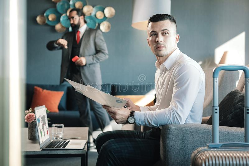 Dark-haired businessman having an important business trip royalty free stock photography