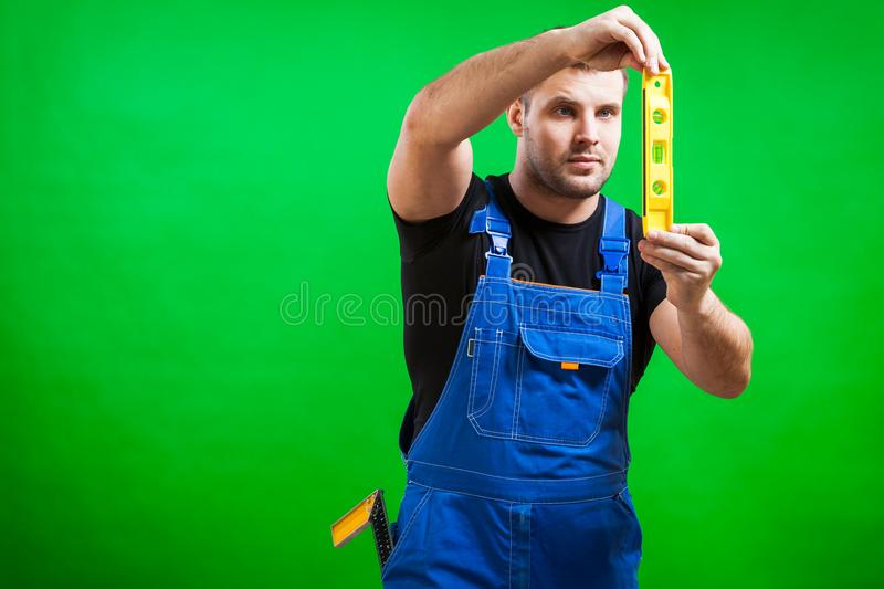 Dark-haired male construction royalty free stock photography