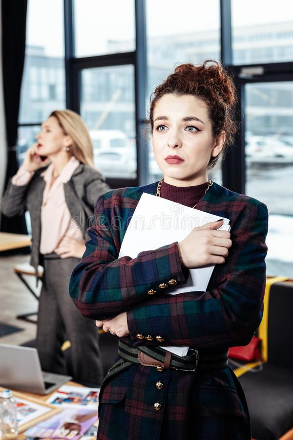 Dark-haired secretary leaving strict boss with negative emotions stock photo