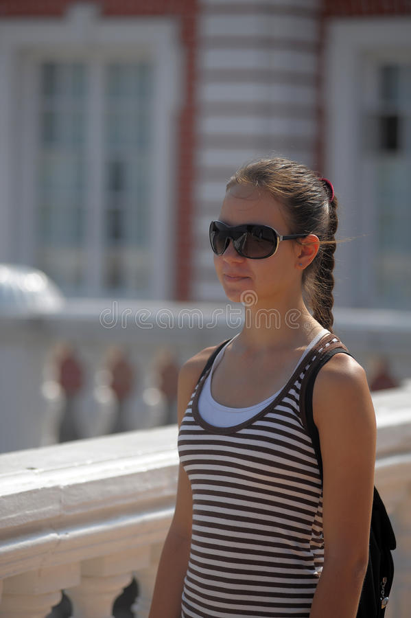 Dark haired teen girl in sunglasses stock photos