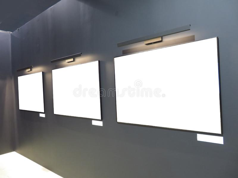 A dark hall in the art gallery template. Black wall with empty f royalty free stock photos