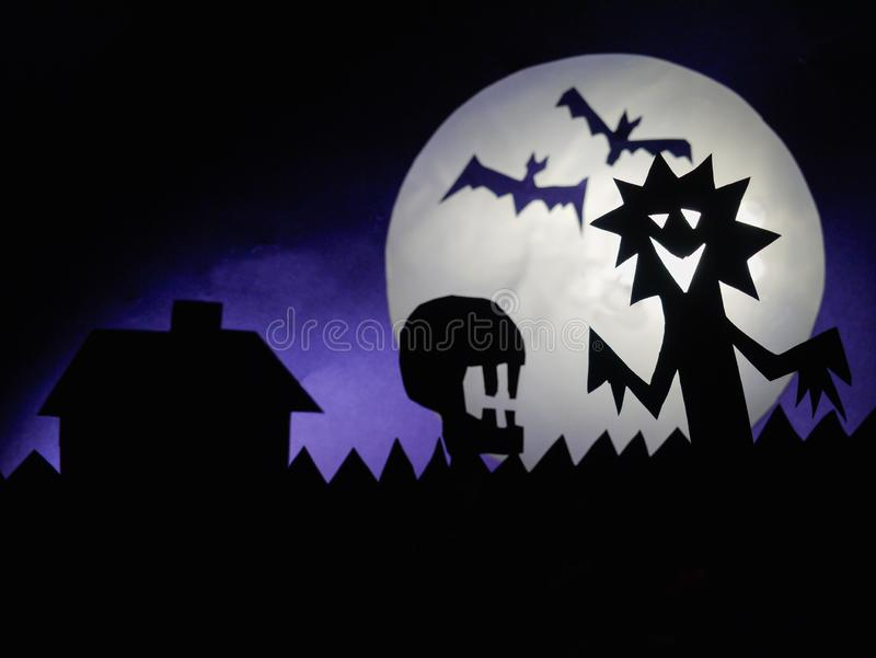Dark Halloween background with scary creatures, Skull, bats, funny monster, full moon royalty free stock photo