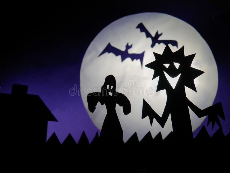 Dark Halloween season background with moon in the background and scary creatures silhouettes.Dark Halloween season background with royalty free stock photo