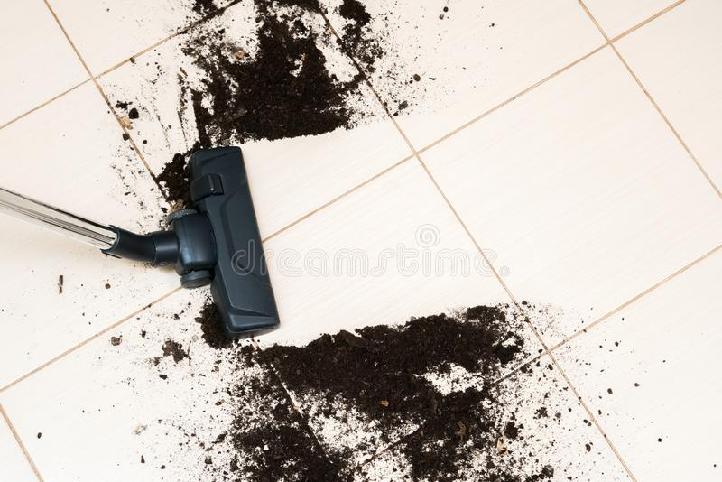 Dark head of a modern vacuum cleaner being used while vacuuming royalty free stock image