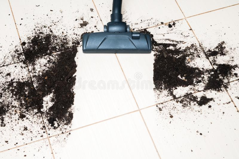Dark head of a modern vacuum cleaner being used while vacuuming royalty free stock photos