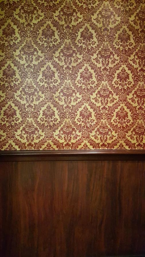Dark interior room with baroque wallpaper. And wood royalty free stock images