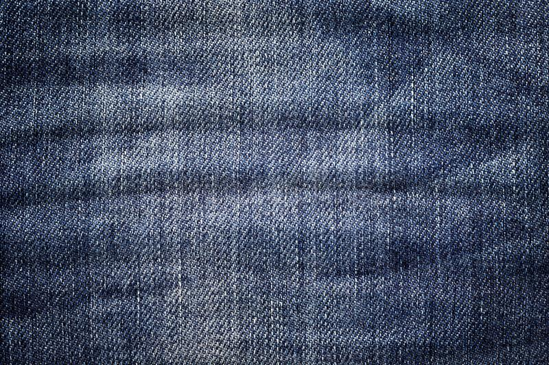 Dark jeans background. Classic denim texture. Surface of fashion clothing. royalty free stock image