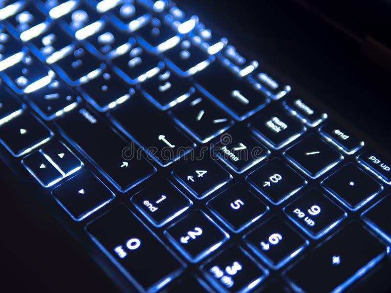 Dark keyboard with blue backlight stock photos