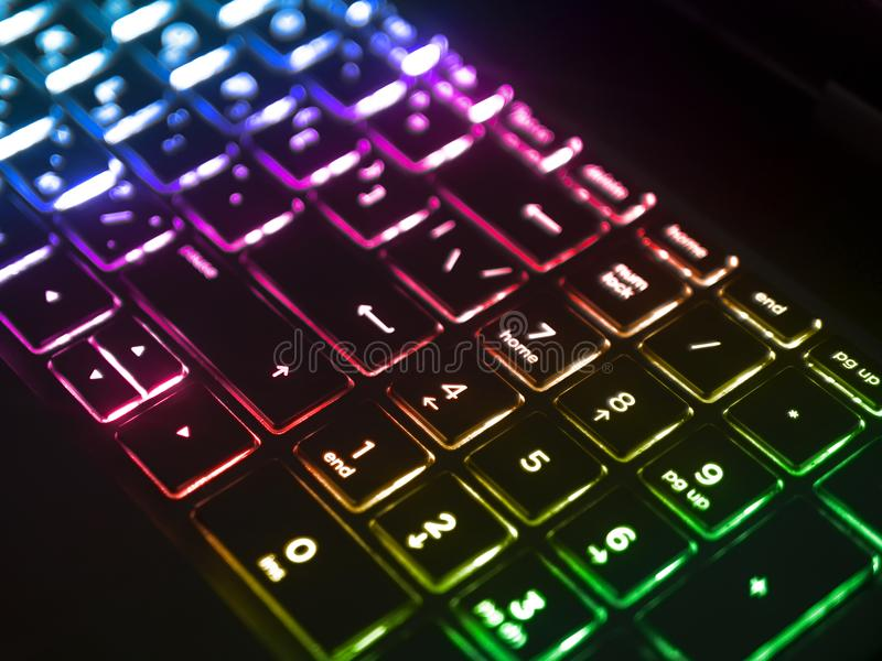 Dark keyboard with blue rgb backlight royalty free stock photography