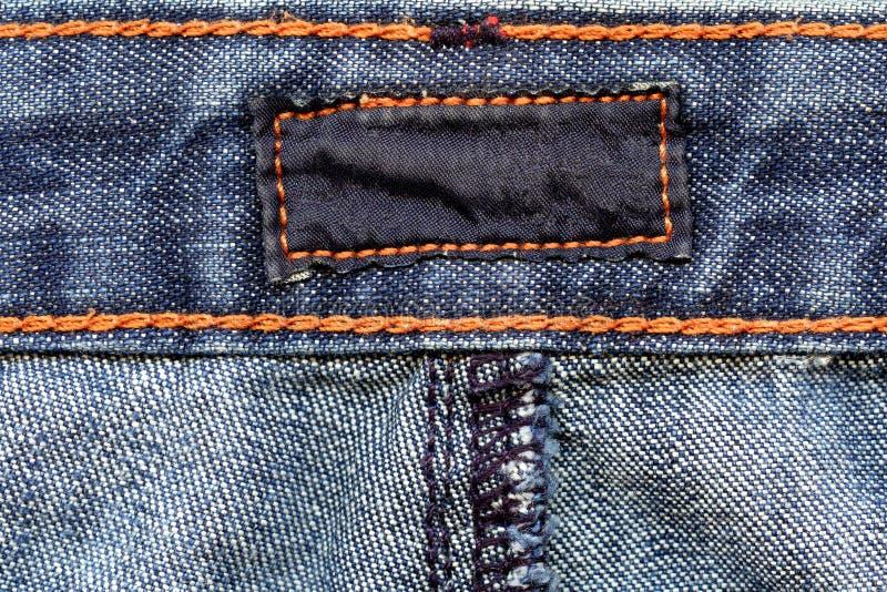 Dark label on jeans stock image