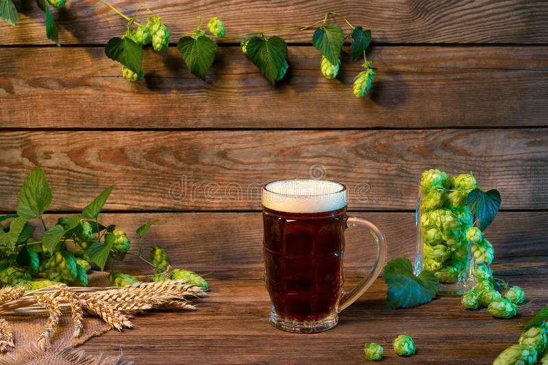 Dark lager beer glass, brown ale on wooden table in bar or pub stock photo
