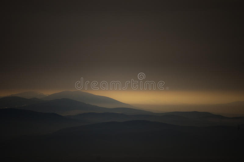 Download Dark Landscape With Mountains At Sunset Stock Photos - Image: 29209253
