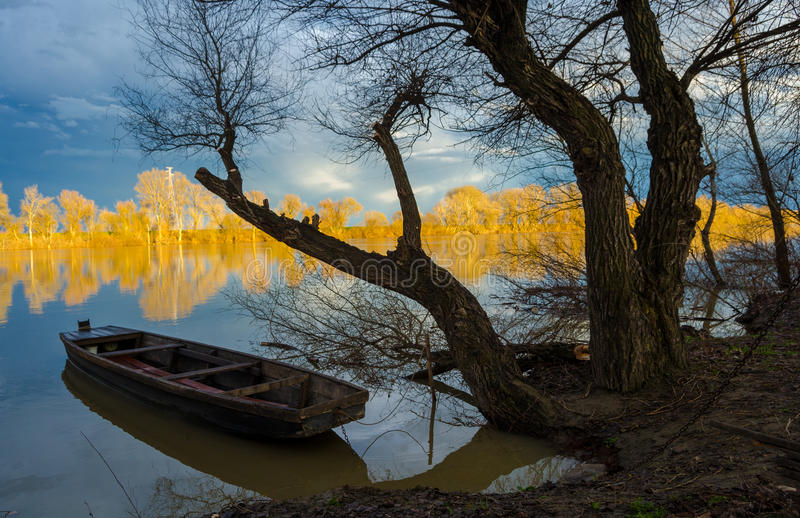 Download Wooden Boat On The River In Fall Stock Photo - Image of landscape, moody: 30020714