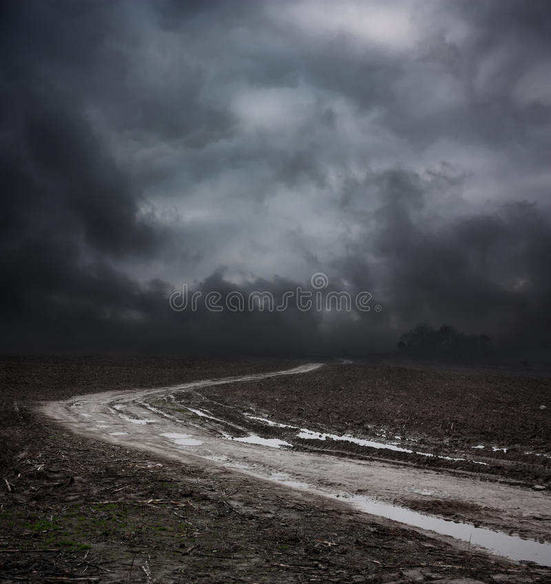Free Dark Landscape With Dirty Road And Moody Sky Royalty Free Stock Photography - 39341827