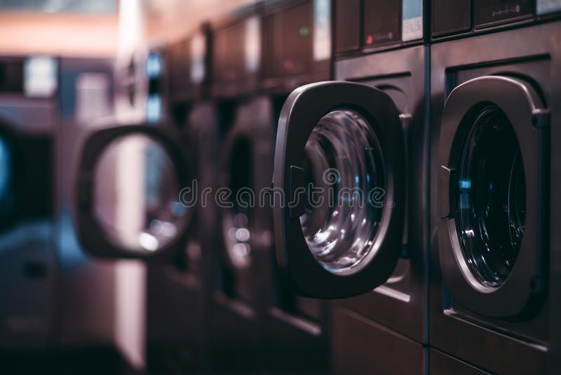 Dark laundry room with machines royalty free stock images