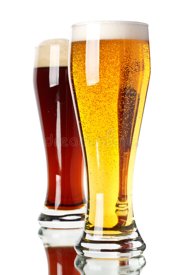 Dark and light beer. Two glasses with dark and light beer on a white background royalty free stock image