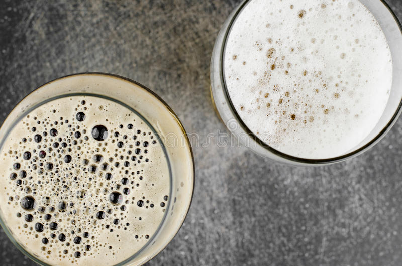 Dark And Light Beers In Glasses. On Scratched Table Top View Closeup stock photography