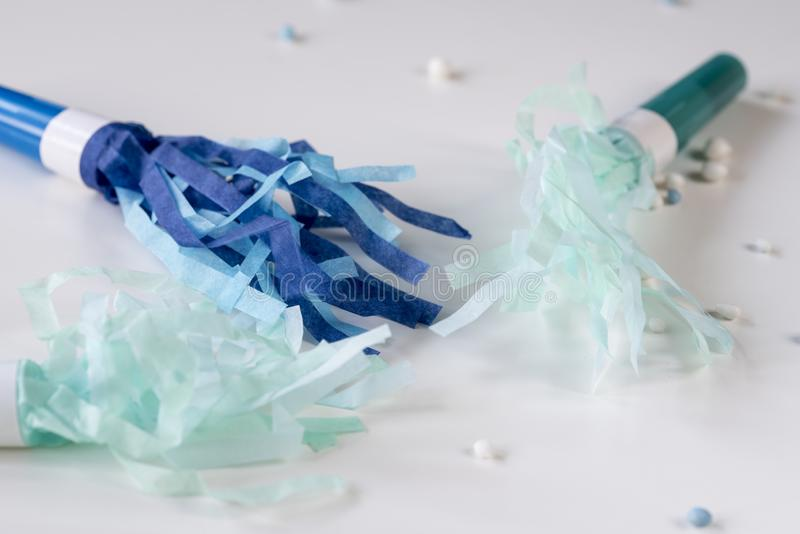 Blue party tooth on white table stock photography