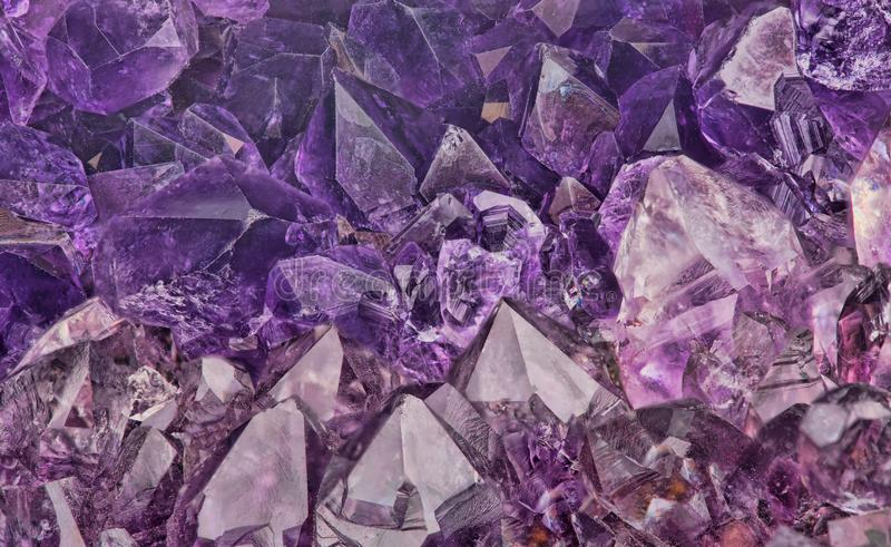 Dark lilac amethyst crystals close-up backgrond royalty free stock photo