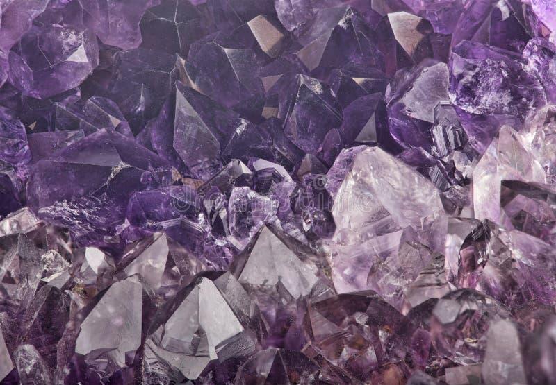 Dark lilac amethyst crystals macro backgrond royalty free stock image