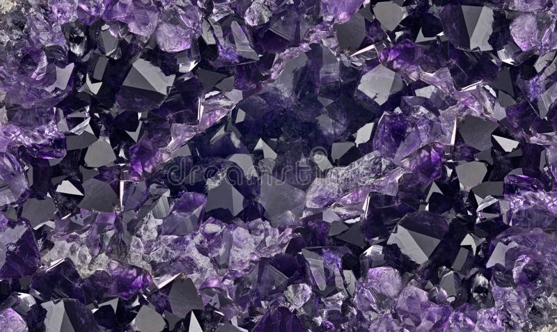 Dark lilac amethysts crystals background royalty free stock photos