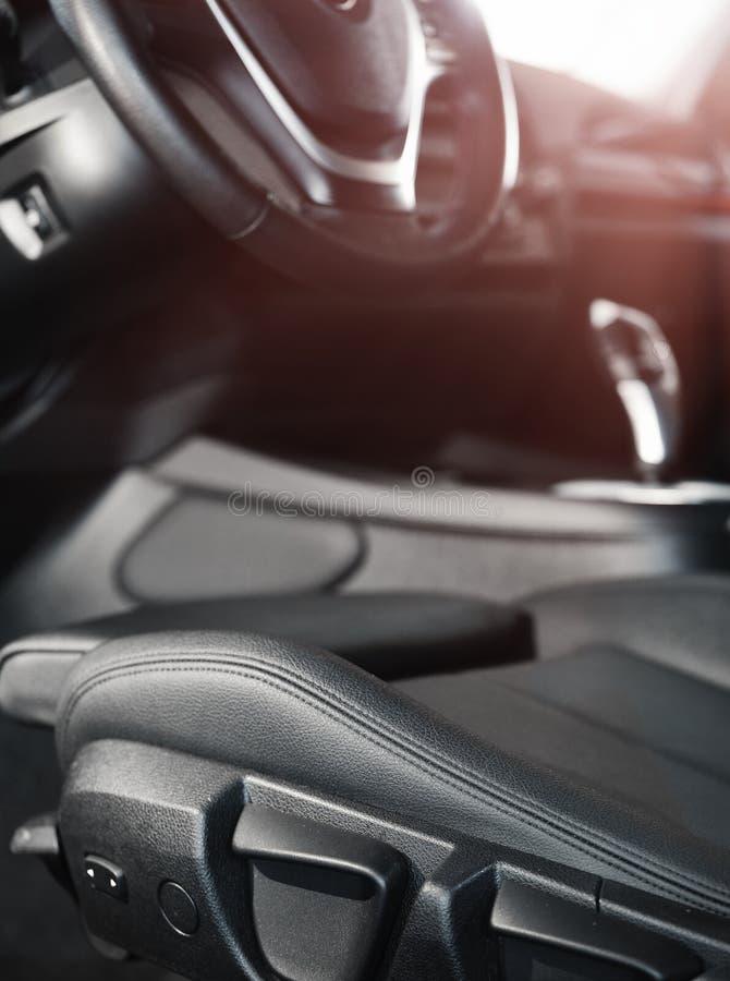 Dark luxury car Interior. steering wheel, shift lever and dashboard stock photos
