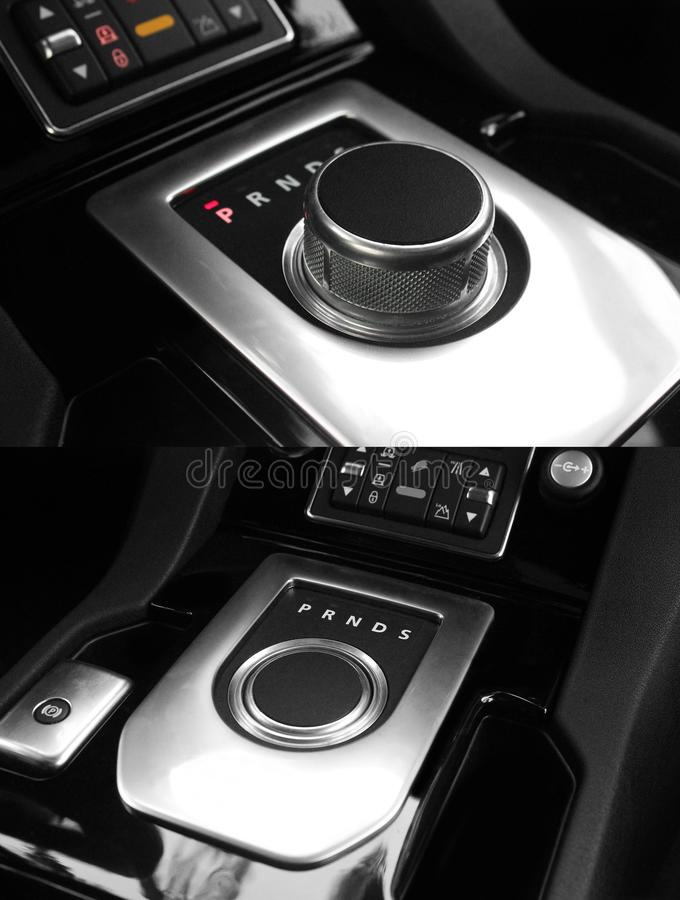 Dark luxury king Interior - Steering wheel, Shift Lever. Tuning. Karbon. Europe. Modern car automatic transmission. Interior royalty free stock photo