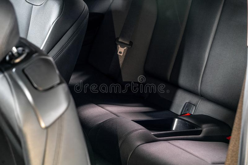 Dark luxury new car Interior. Back passenger seats in modern car, side view stock image