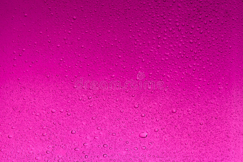 Dark magenta water drops abstract background stock images