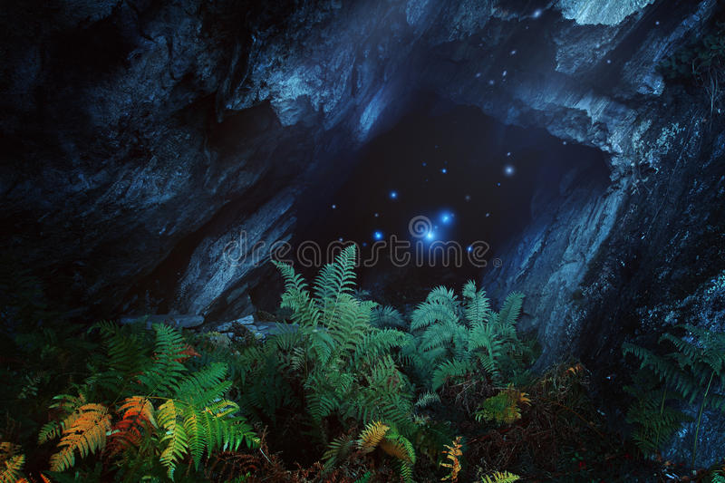 Dark magical cave with mountain spirits stock photo