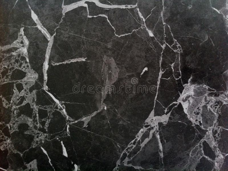 Dark marble texture. Polished natural stone with white veins, lines. royalty free illustration