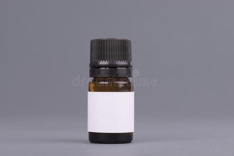Dark medicine glass bottle jar, essential oil brown bottle. Mock up bottle with dropper. Container for perfume. Medical. Bank. Photo stock image