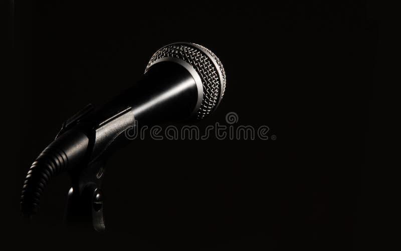 Dark mic. A dark microphone isolated on black royalty free stock photos