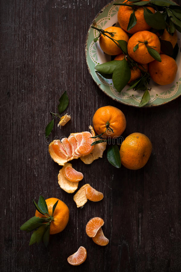 Dark moody food image of fresh ripe orange. On wooden table - still life photography. vintage style stock images