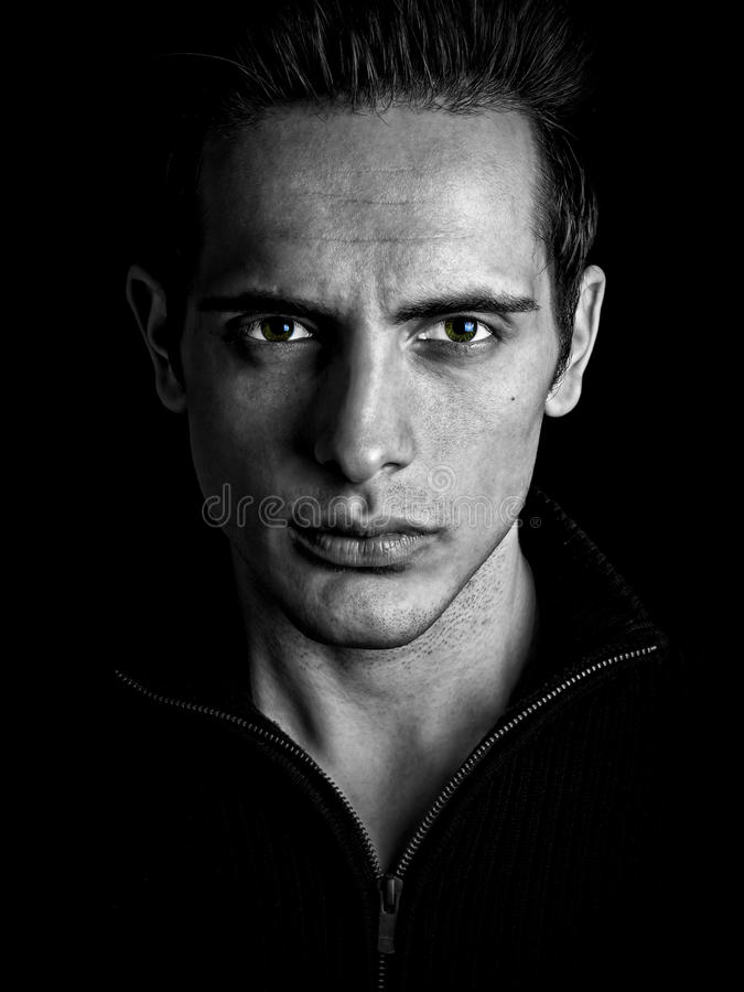 Dark Mysterious Male Stares Intensely. At Viewer royalty free stock image