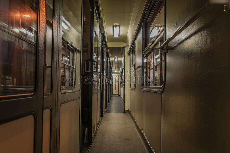 Dark night corridor with doors to compartments in czech train. Dark night corridor with doors to compartments in czech old fast train stock images
