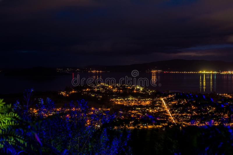 Dark night fallen over Rotorua city and the lake stock photos