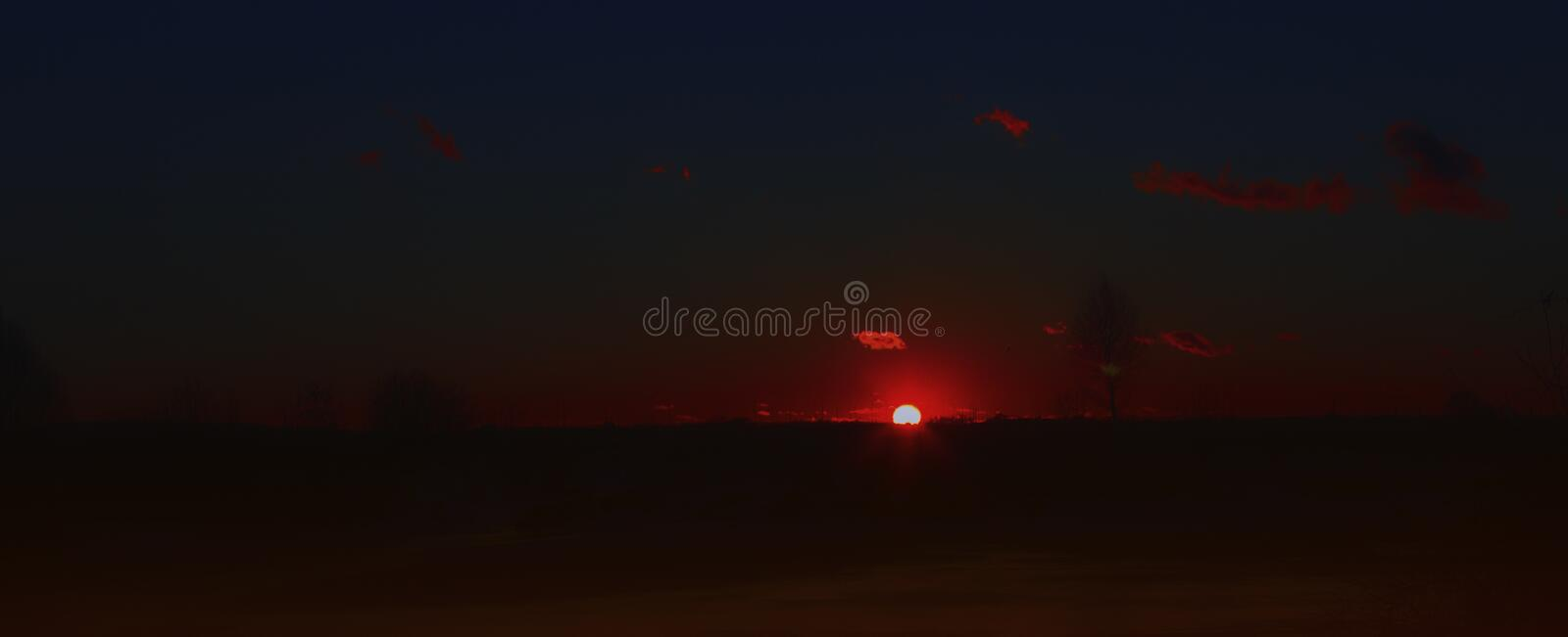 Dark Night Landscape With Glowing Red Sunset stock photography
